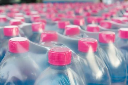 Rows of water bottles in plastic wrap photo
