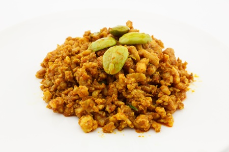 fried pork with yellow curry paste and Stink Beans Thai food  isolated on white background photo
