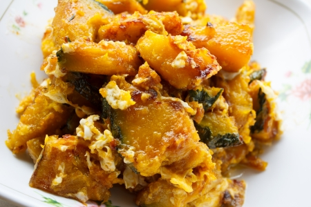 Stir-fried pumpkin with egg  Imagens