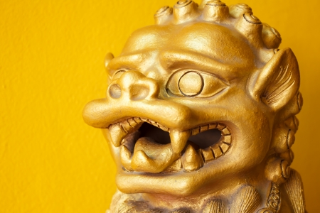 Chinese golden head leo statue on white yellow background photo