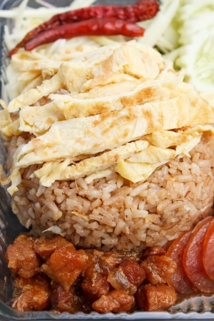 Mixed cooked rice with shrimp paste sauce (thai food) photo