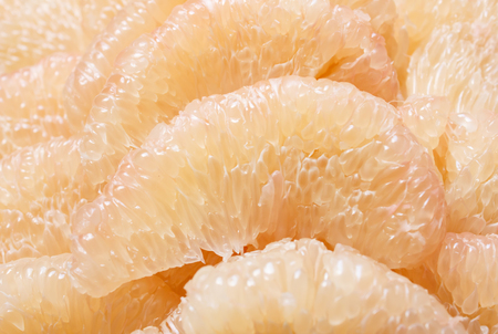 close up peeled pomelo pieces fruit photo