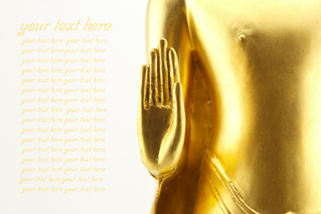 golden hand buddha statue isolated on white background photo