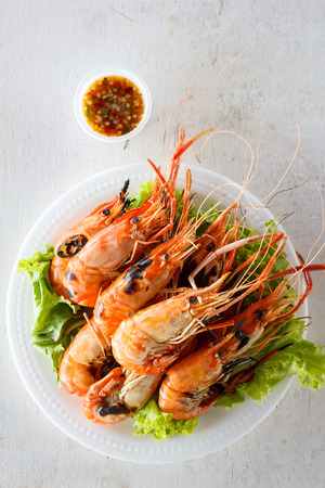 Top view grilled prawns with seafood sauce