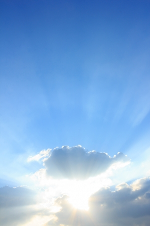 blue sky with sun and clouds for background Standard-Bild