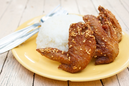 Fried chicken wings sesame with rice photo