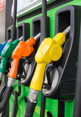 fillup: Gas pump nozzles in a service station Stock Photo