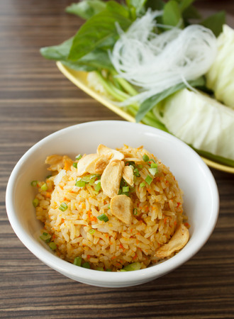 Fried rice with garlic on wooden table photo