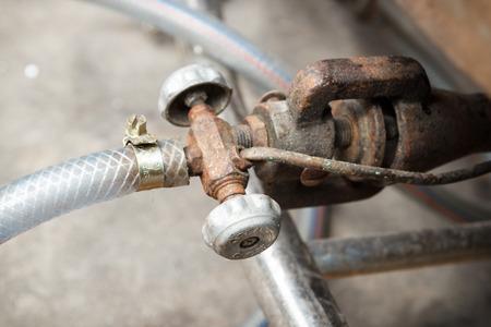 old rusty gas stove valve photo