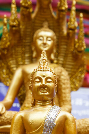 Two face buddha statue in Thailand photo