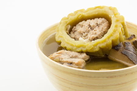 Stuffed bitter gourd with minced pork in clear soup photo