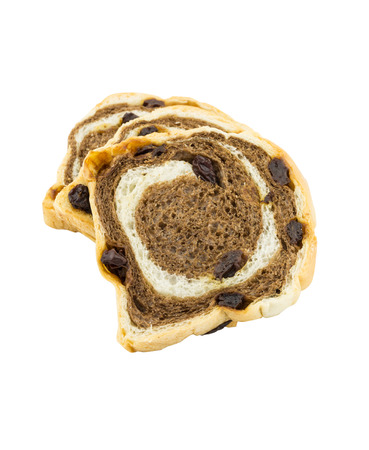 Sliced raisin chocolate bread on white background photo