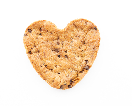 Heart shape chocolate chip cookie isolated on white background photo