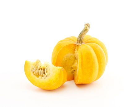 Sliced small pumpkin on white background photo