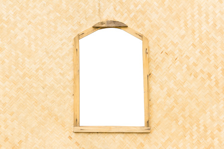 Thai style bamboo wall with window frame isolated on white background photo