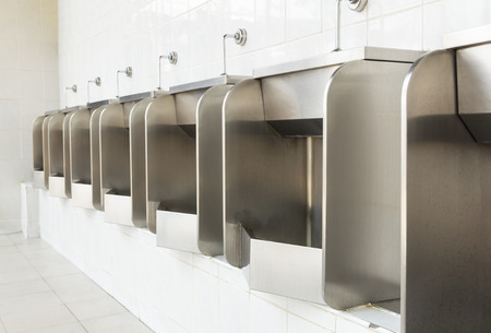 ventilate: stainless urinals at public restroom Stock Photo