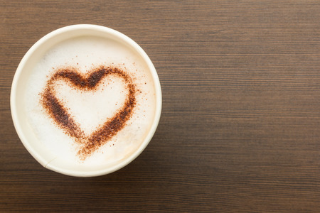 hot chocolate drink: paper cup of coffee with heart symbol Stock Photo