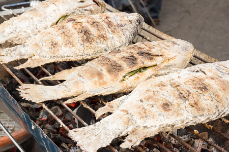 silver perch: Grilled white snapper fish coated rock salt - Thai food Stock Photo