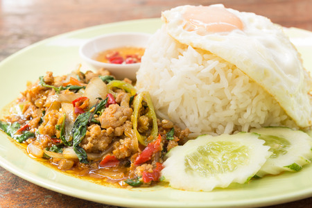 Rice topped with stir fried minced pork and holy basil - Thai food photo
