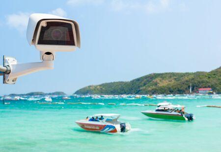 cctv camera at beach and sky background photo