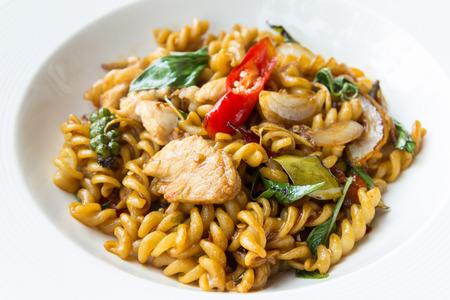 stir fried spicy fusilli with pork - thai food photo