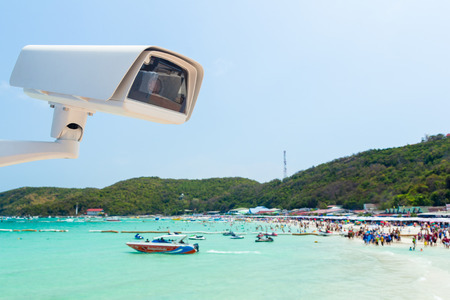 cctv camera with beach and sky background photo