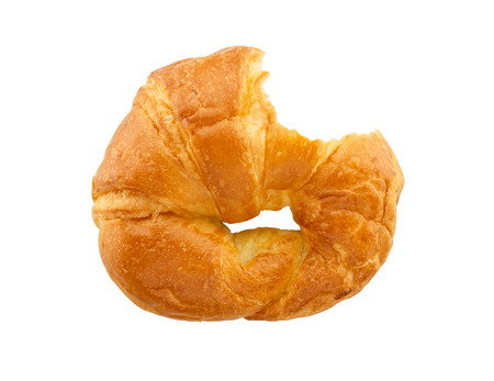 bitten: bitten croissant isolated on white background Stock Photo