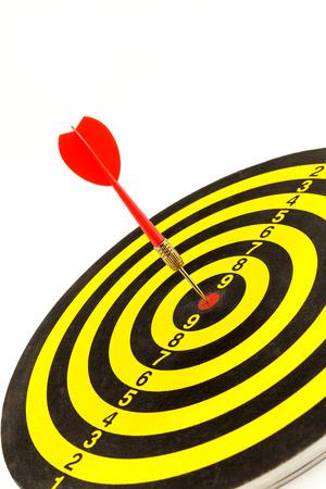 dartboard: Red darts arrows in bullseye of dartboard Stock Photo