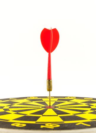 bullseye: Red darts arrows in bullseye of dartboard Stock Photo
