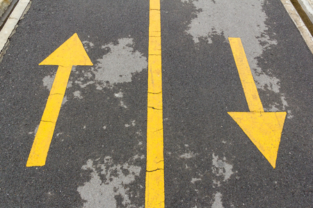 yellow directional arrow signs of  bicycle lane