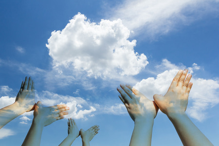 shaped hands: Bird shaped hands on cloud and sky background Stock Photo
