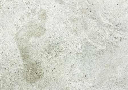 faded: Faded footprints in cement floor