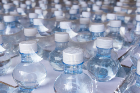 Rows of water bottles in plastic wrap Imagens