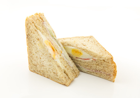 boiled egg and ham sandwich on white background