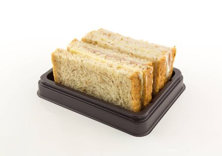 ham cheese sandwich in tray on white background