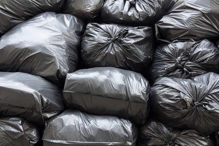 environmental sanitation: pile of black garbage bags Stock Photo