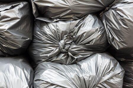 environmental sanitation: Close up pile of black garbage bags