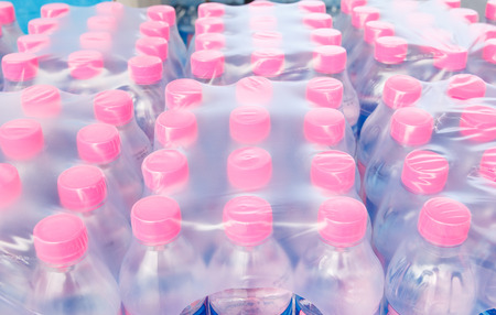 bottled: Rows of bottled water in plastic pack Stock Photo
