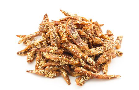crispy anchovy fish with sesame on white background , thai food