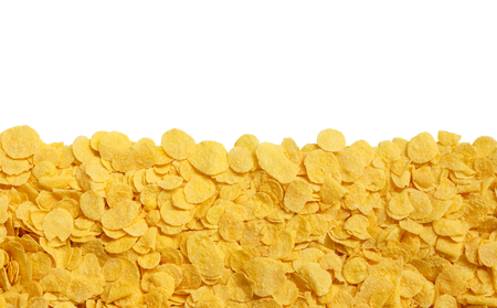 yellow crispy cornflakes isolated on a white background
