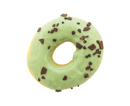 chocolate sprinkles: green donut with chocolate sprinkles isolated on white background Stock Photo