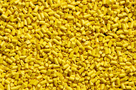 close up yellow plastic resin ( Masterbatch ) for background