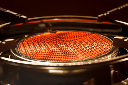 close up of orange flame infrared stove
