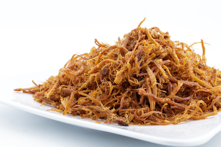 crispy dried shredded pork on white background - thai food Stock Photo