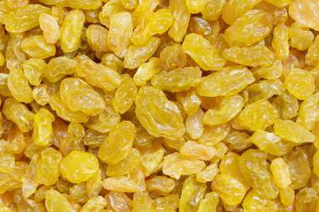 top view of dried golden raisins for background