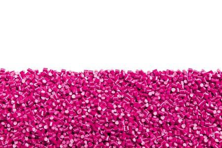 pink plastic resin ( Masterbatch ) with copy space isolated on white background