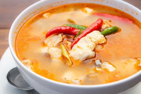 close up of spicy soup with clown featherback fish, thai food Imagens