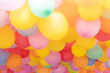 a lot of colorful balloons for a background