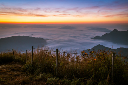 sunrise over fog and mountian at Phu chifa, Chiang Rai, Thailand.