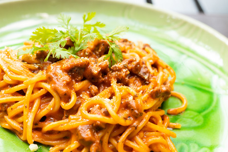 close up of spaghetti meat sauce on plate Imagens
